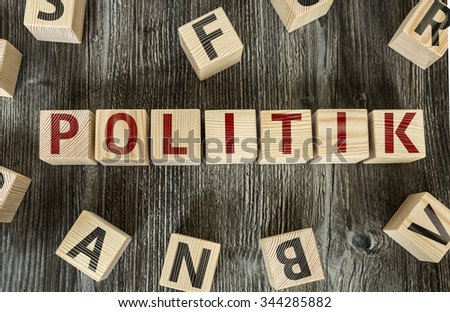 Wooden Blocks with the text: Politics (in German) - stock photo