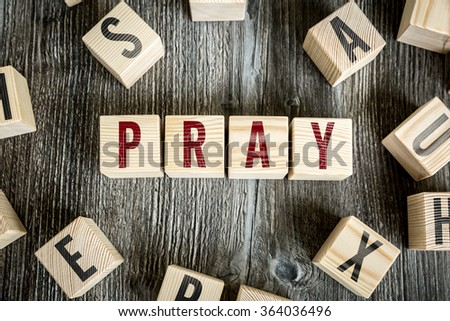 Wooden Blocks with the text: Pray - stock photo