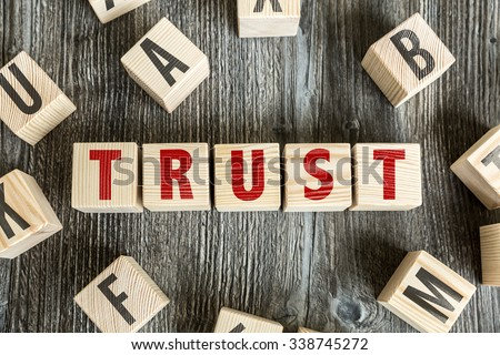 Wooden Blocks with the text: Trust - stock photo