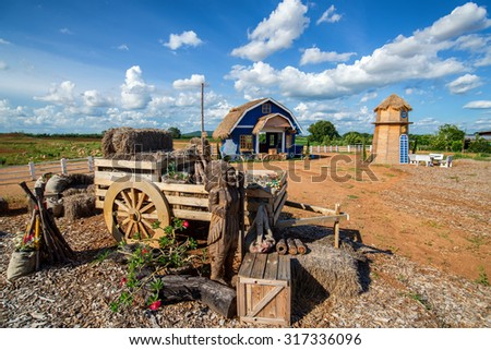 Wooden blue house and farm buildings in the countryside.  - stock photo