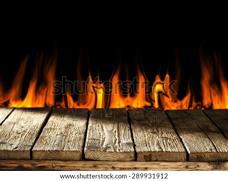 wooden board and fire  - stock photo