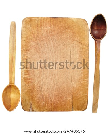 Wooden board and spoons isolated over white background with copyspace - stock photo