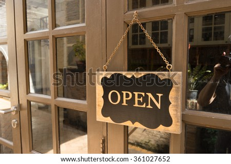 Wooden board sign that says Open from a restaurant - stock photo