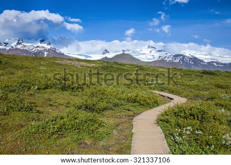 Wooden boardwalk at the Skaftafell National Park in Iceland - stock photo