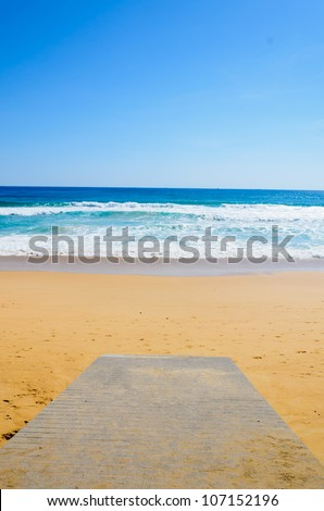 wooden  Boardwalk on the beach and tropical sea - stock photo