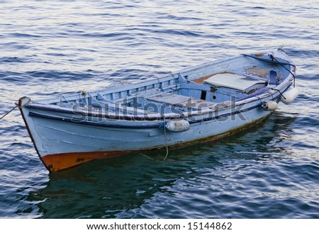 Wooden boat at the sea