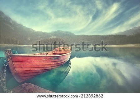 wooden boat on a mooring mountain lake - stock photo