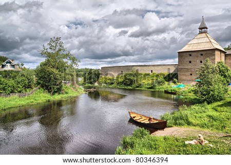 wooden boat on coast river - stock photo