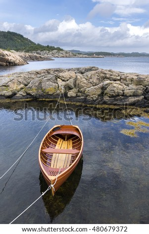 wooden boat on the coast of Mandal in Norway