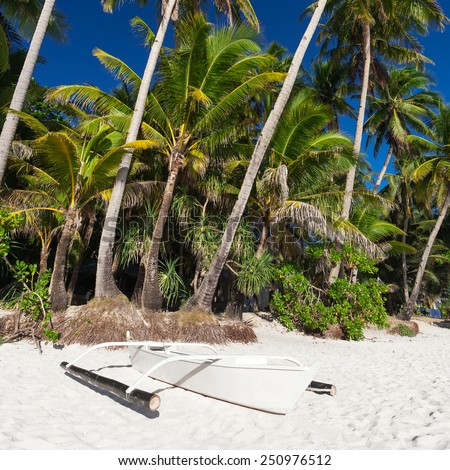 Wooden boat on tropical beach with coconut palm trees, Philippines, Boracay  - stock photo