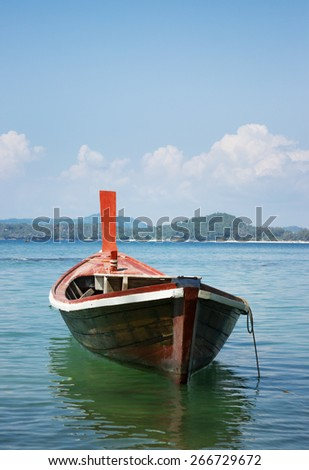 Wooden boat on  tropical sea bay.  Phuket. Thailand - stock photo