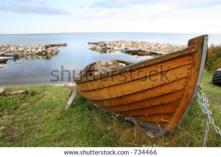 Wooden boat ready to go - stock photo