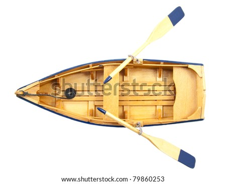 Wooden boat with paddles isolated over white - stock photo