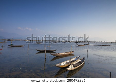 Wooden boats in Cau Hai lagoon, Pha Tam Giang, Hue, Vietnam  - stock photo