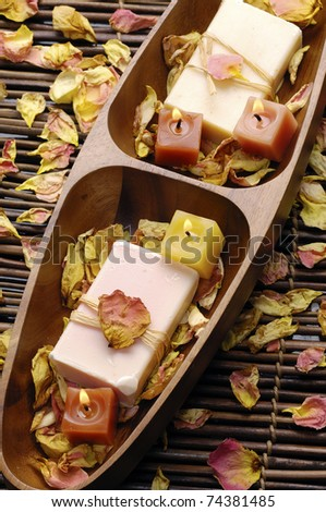 Wooden bowl of natural handmade with rose withered petals - stock photo