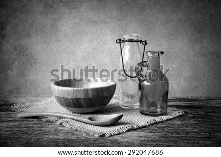wooden bowl on wooden table over grunge background, rustic style, Black and white  - stock photo