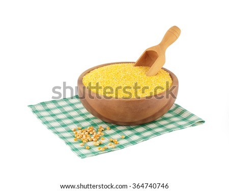 wooden bowl with corn grain on a napkin - stock photo