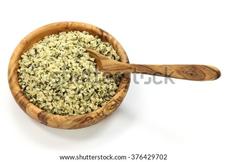 wooden bowl with hemp seeds isolated on white background - stock photo