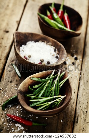 wooden bowls with fresh herbs and spices - stock photo