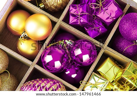 Wooden box filled with Christmas decorations background - stock photo