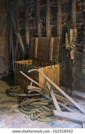 wooden box in shed with tools - stock photo