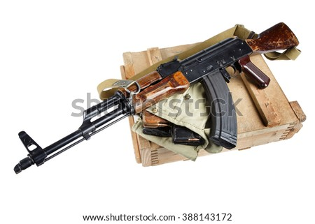wooden box of ammunition with AK rifle and ammunition isolated - stock photo