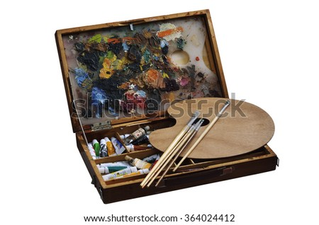 wooden box with paints, brushes and palette - stock photo