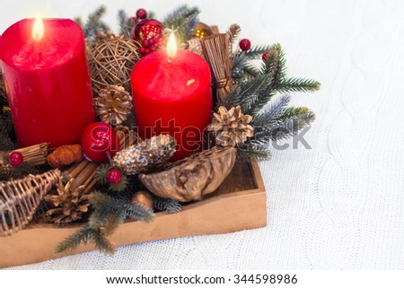 Wooden box with vintage Christmas decoration from above on the white background.Soft focus