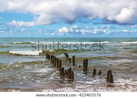 Wooden breakwater in the stormy Baltic sea