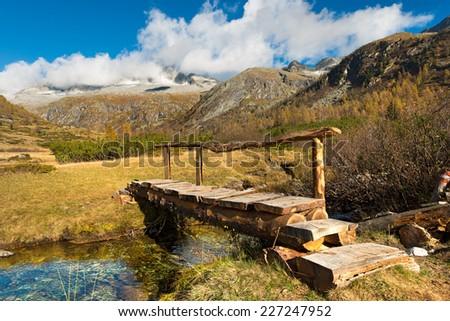 Wooden Bridge - Adamello Trento Italy / Small wooden bridge of a trekking path in the National Park of Adamello Brenta, Val di Fumo. Trentino Alto Adige, Italy - stock photo
