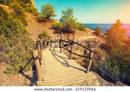 wooden bridge in autumn park - stock photo