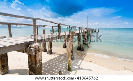 Wooden bridge into the sea.One of the most beautiful and most popular beaches on Koh Samet.Crystal Sand Beach at Samet Island - stock photo