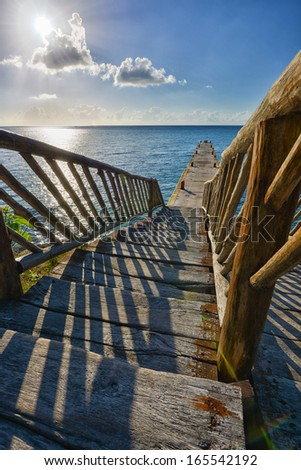 Wooden bridge on a beach in Cozumel, Mexico - stock photo