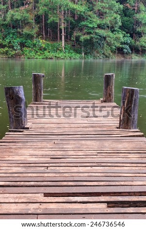 Wooden bridge over a river in province of Pai Mae Hong Son, Thailand - stock photo
