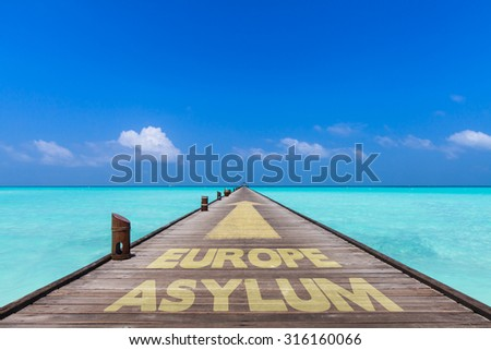 wooden bridge over the mediterranean sea with the words Asylum and Europe on the planks. Concept for a safe way for refugees to Europe - stock photo