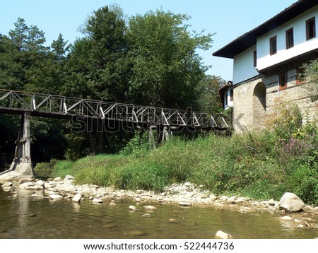 wooden bridge over the river to monastery