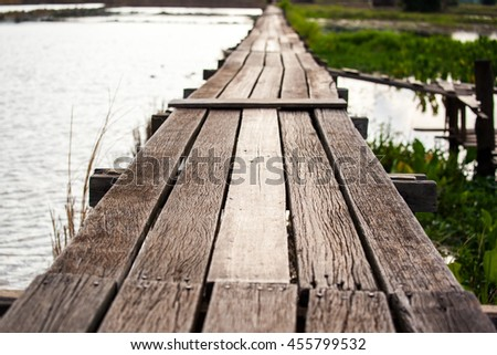 Wooden bridge through the field