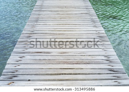 Wooden Bridge to the sea,blue sea