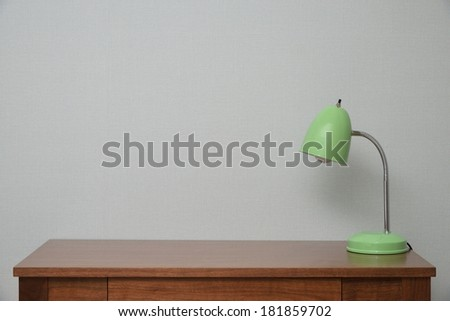 wooden Brown Table with a Lamp in bedroom - stock photo