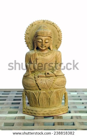 Wooden Buddha on white background
