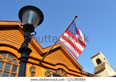 Wooden building with American flag