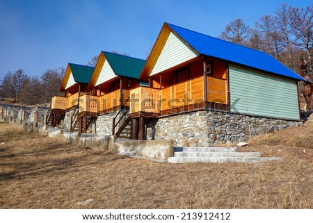 Wooden bungalows in camping site near Baikal lake