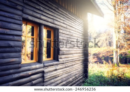 Wooden cabin in autumn forest  - stock photo