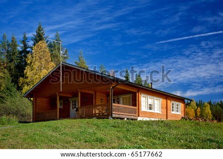 Wooden cabin in the forest - stock photo
