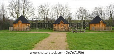 Wooden cabins at camping site in Lee Valley Park - stock photo