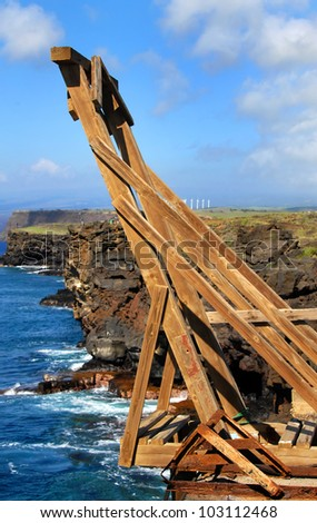 Wooden canoe hoist replaces the rusted metal hoist used in years past to hoist canoes from the water far below the rugged and high cliffs of South Point on the Big Island of Hawaii.