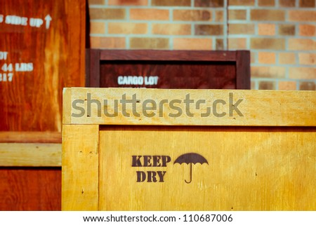 Wooden cargo crates stacked in a warehouse - stock photo