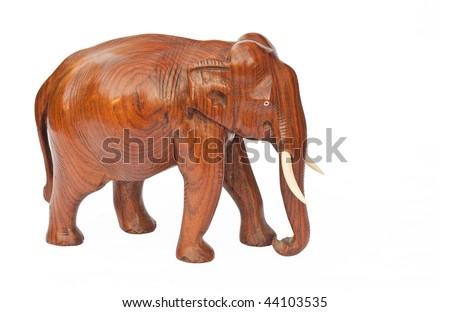 Wooden carved elephant isolated on white background - stock photo