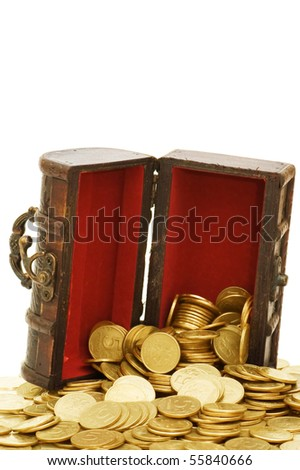 Wooden casket full of coins isolated on white - stock photo