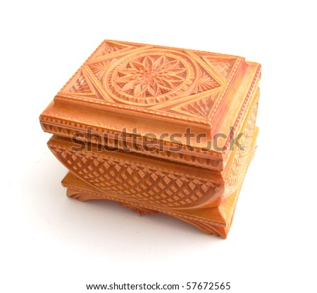 Wooden casket with a carving  on a white background - stock photo